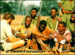 Mark Owens with poachers and NLNP Game Scouts