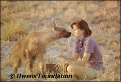 Delia Owens greets the brown hyena Pepper.
