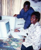 Hammer Simwinga and NLWCCDP secretary Mubanga Muwansa using a compter provided by Harvest Help.
